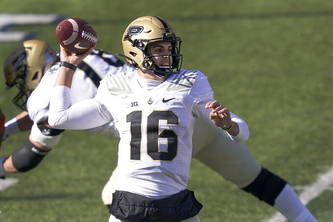Purdue quarterback Aidan O'Connell passes during the first half of an NCAA college football game against Illinois Saturday, Oct. 31, 2020, in Champaign, Ill. (AP Photo/Charles Rex Arbogast)