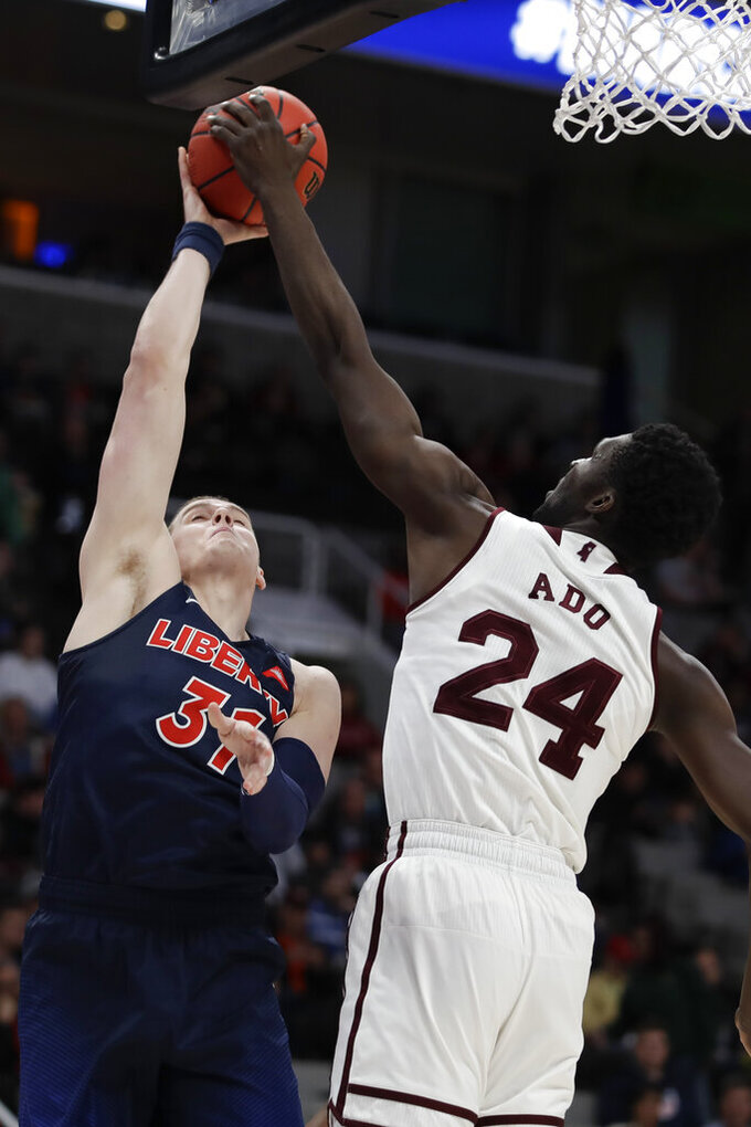 Mississippi State forward Abdul Ado, right, blocks a shot by Liberty forward Scottie James during the second half of a first-round game in the NCAA men's college basketball tournament Friday, March 22, 2019, in San Jose, Calif. (AP Photo/Ben Margot)