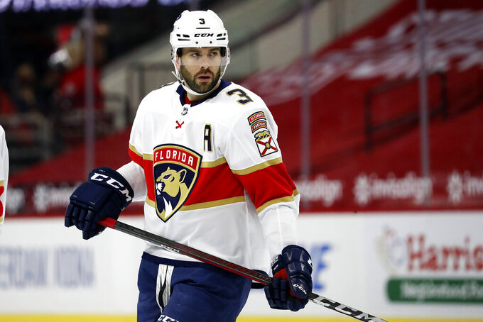 Florida Panthers' Keith Yandle (3) waits for a face-off against the Carolina Hurricanes during the first period of an NHL hockey game in Raleigh, N.C., Sunday, March 7, 2021. (AP Photo/Karl B DeBlaker)