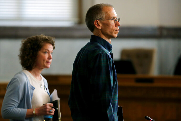FILE -In this May 17, 2018, file photo Ron Plush, father of Kyle Plush, and his sister-in-law Jody, left, listening to comments from Mayor John Cranley during the City Council's law and public safety committee on the response to the death of Seven Hills student Kyle Plush. Plush, 16, died after being trapped by a fold-up vehicle seat despite making two 911 calls. On Wednesday, Jan. 22, 2020, an Ohio judge will rule on whether to move forward with a lawsuit filed by the family of Plush. The suit, filed last year, charges the city, a former city official and four city employees with actions it alleges led to Plush's 2018 death.  (Kareem Elgazzar/The Cincinnati Enquirer via AP, File)