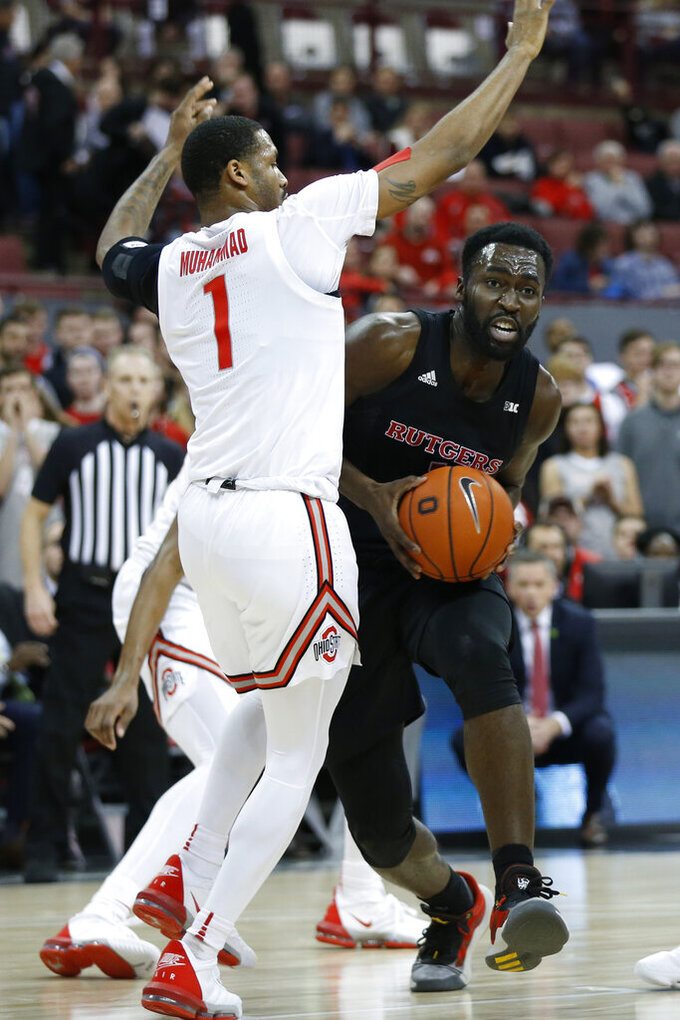 Rutgers Akwasi Yeboah, right, tries to drive the lane as Ohio State's Luther Muhammad defends during the first half of an NCAA college basketball game Wednesday, Feb. 12, 2020, in Columbus, Ohio. (AP Photo/Jay LaPrete)