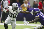 Oakland Raiders running back Jalen Richard (30) tries to break a tackle by Minnesota Vikings running back Ameer Abdullah, right, during the first half of an NFL football game, Sunday, Sept. 22, 2019, in Minneapolis. (AP Photo/Jim Mone)