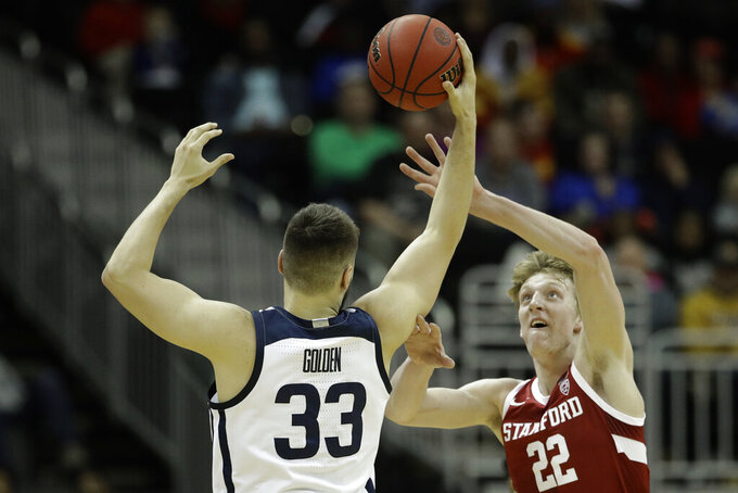 Stanford forward James Keefe (22) tries to steal the ball from Butler forward Bryce Golden (33) during the first half of an NCAA college basketball game Tuesday, Nov. 26, 2019, in Kansas City, Mo. (AP Photo/Charlie Riedel)