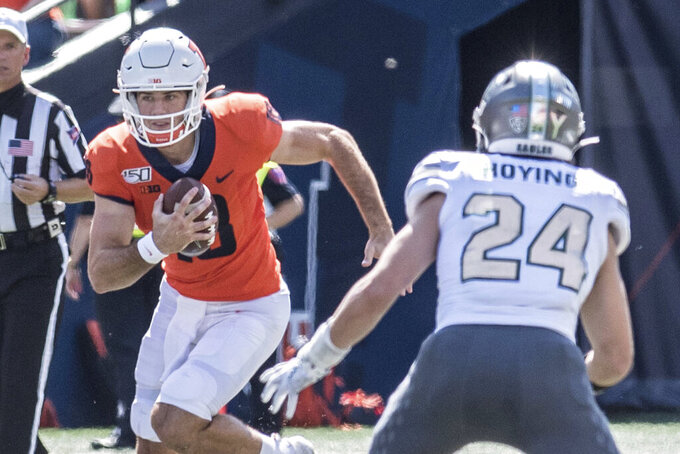 Illinois quarterback Brandon Peters (18) runs the ball as Eastern Michigan's Brody Hoying (24) defends in the first half of a NCAA college football game between Illinois and Eastern Michigan, Saturday, Sept.14, 2019, in Champaign, Ill. (AP Photo/Holly Hart)