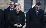 German Chancellor Angela Merkel and Polish Prime Minister Mateusz Morawiecki, from left, visit the former Nazi death camp of Auschwitz-Birkenau in Oswiecim, Poland on Friday, Friday, Dec. 6, 2019. Merkel attend an event in occasion of the 10th anniversary of the founding of the Auschwitz Foundation. (Photo/Markus Schreiber)