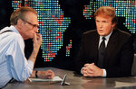 FILE - In this Oct. 7, 1999 file photo, Donald Trump, right, is interviewed by Larry King during a taping of