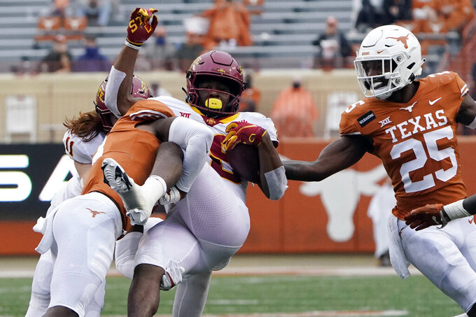 Iowa State defensive back Vonzell Kelley III (29) is upended by Texas defensive back Jalen Green (3) during the first half of an NCAA college football game, Friday, Nov. 27, 2020, in Austin, Texas. (AP Photo/Eric Gay)