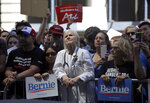 Dr. Rene Rubin listens to Democratic presidential candidate Bernie Sanders, I-Vtt., make remarks at a rally alongside unions, hospital workers and community members against the closure of Hahnemann University Hospital in Philadelphia, Monday July 15, 2019. (AP Photo/Jacqueline Larma)