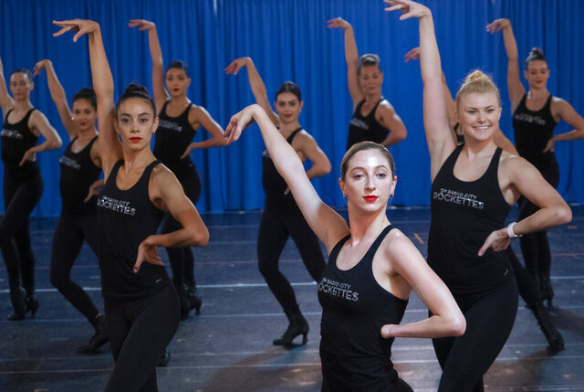 In this Oct. 22, 2019 photo, Rockette Sydney Mesher center right, takes part in a rehearsal at the Rockette's rehearsal space in New York. Mesher, who was born without a left hand due to the rare congenital condition symbrachydactyly, is the first person with a visible disability ever hired by New York's famed Radio City Rockettes. (AP Photo/Craig Ruttle)