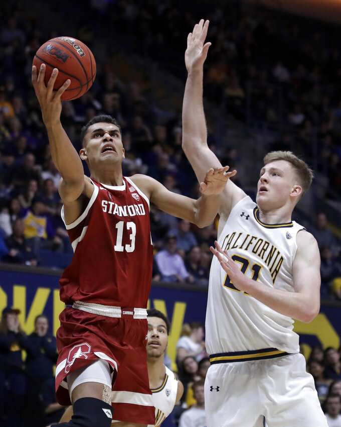 Stanford's Oscar da Silva (13) lays up a shot past California's Lars Thiemann, right, in the first half of an NCAA college basketball game Sunday, Jan. 26, 2020, in Berkeley, Calif. (AP Photo/Ben Margot)