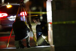 Authorities investigate the scene of a shooting Thursday, Dec. 5, 2019, in Miramar, Fla. Four people, including a UPS driver, were killed Thursday after robbers stole the driver's truck and led police on a chase that ended in gunfire at a busy Florida intersection during rush hour, the FBI said. (AP Photo/Brynn Anderson)