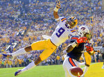 FILE - In this Oct. 14, 2017, file photo, LSU safety Grant Delpit (9) prevents Auburn wide receiver Eli Stove (12) from scoring a touchdown in the first half of an NCAA college football game in Baton Rouge, La. Delpit was an AP All-American last season and starts this season as a preseason All-American selected by poll voters. (AP Photo/Matthew Hinton, File)