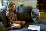 In this Thursday, May 3, 2018 photo, Nora Nissenbaum, 12, pauses during an interview with The Associated Press in Wayne, Pa. The case of a suburban Philadelphia boy who was quietly allowed to return to class after being accused of making a shooting threat has thrown a spotlight on the hard decisions school authorities must make. Nora who says the boy bullied her has withdrawn from class for fear of him.   (AP Photo/Matt Slocum)