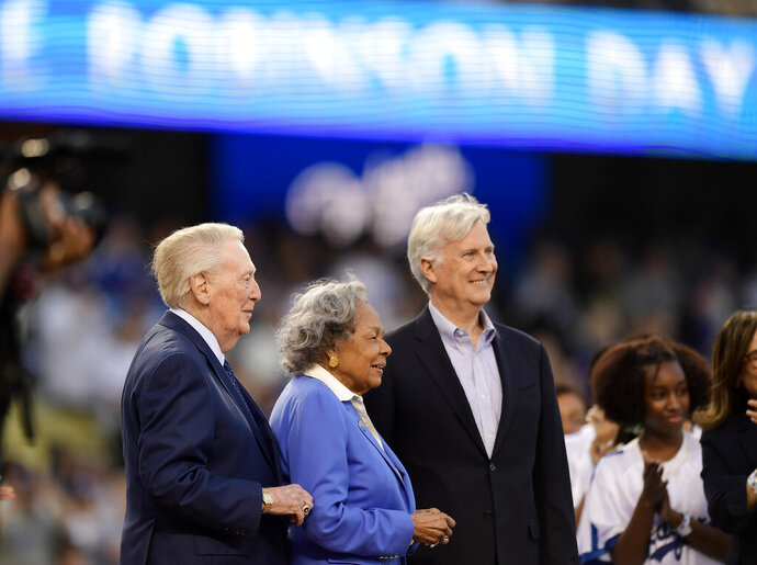 Former Los Angeles Dodgers broadcaster Vin Scully, left, stands with Jackie Robinson's widow Rachel Robinson, center, and Dodgers co-owner Mark Walter prior to a baseball game between the Dodgers and the Cincinnati Reds, Monday, April 15, 2019, in Los Angeles. (AP Photo/Mark J. Terrill)