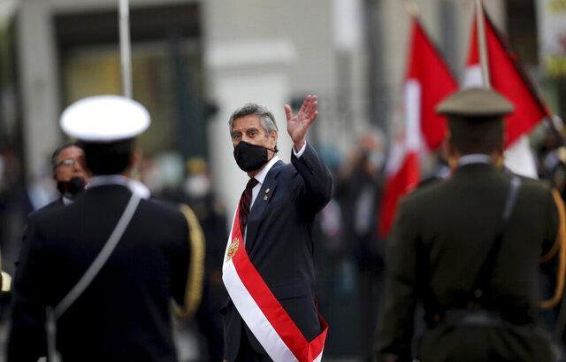 Francisco Sagasti waves after being sworn-in as the new, interim president at Congress in Lima, Peru, Tuesday, Nov. 17, 2020. Sagasti's appointment marks a tumultuous week in which thousands took to the streets outraged by Congress' decision to oust popular ex-President Martín Vizcarra. (AP Photo/Rodrigo Abd)