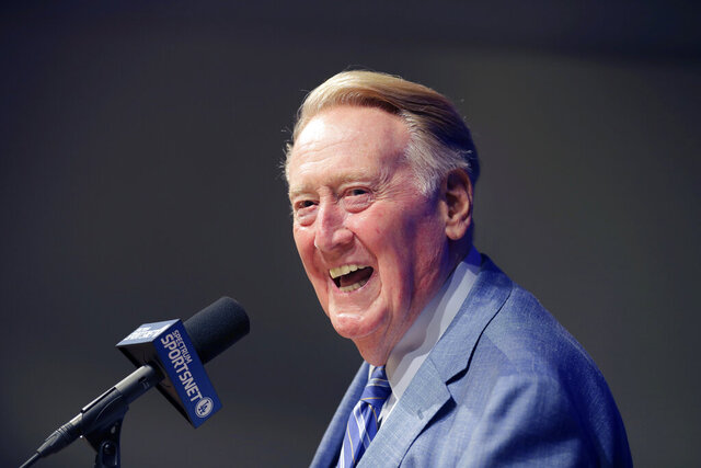 FILE - In this Sept. 24, 2016 file photo, Los Angeles Dodgers broadcaster Vin Scully answers questions during a news conference at Dodger Stadium in Los Angeles. Scully took a fall in his home Tuesday, April 21, 2020, and was taken to the hospital, where he was