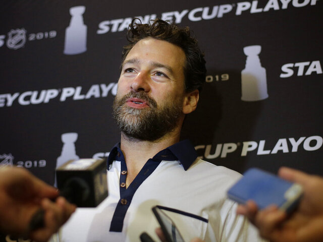 FILE - In this May 8, 2019, file photo, Carolina Hurricanes' Justin Williams faces reporters during a media availability in Boston. Justin Williams is back with the Carolina Hurricanes. The question now is how long it will take him to be ready for game action. The 38-year-old former captain said Wednesday, Jan. 8, 2020, he isn't sure exactly when he'll be ready to play, though he has been skating and working out in hopes of easing the transition back to the ice after he stepped away from the sport last fall. (AP Photo/Steven Senne, File)