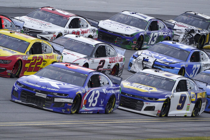 Bubba Wallace (43) drives in traffic during the YellaWood 500 NASCAR auto race at Talladega Superspeedway, Sunday, Oct. 4, 2020, in Talladega, Ala. (AP Photo/John Bazemore)