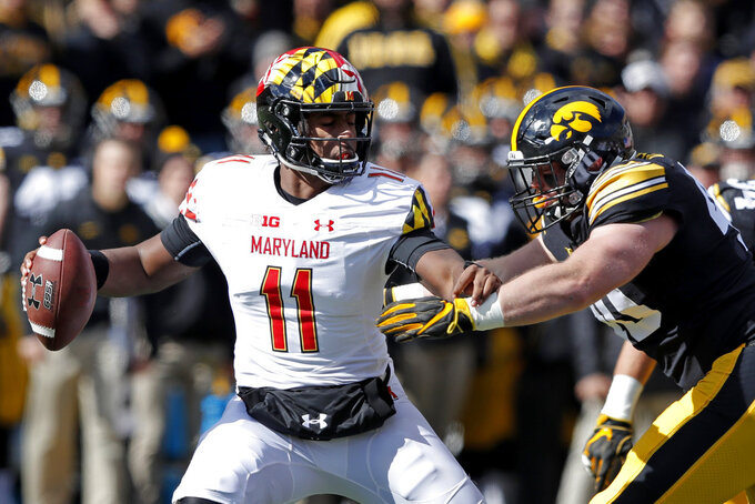 Maryland quarterback Kasim Hill (11) is sacked by Iowa defensive end Parker Hesse during the second half of an NCAA college football game, Saturday, Oct. 20, 2018, in Iowa City, Iowa. Iowa won 23-0. (AP Photo/Charlie Neibergall)