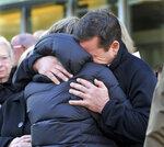 Conrad Roy, Jr., right, father of texting suicide victim Conrad Roy III, and Conrad III's aunt Becky Maki hug after a hearing Monday, February 11, 2019 where defendant Michelle Carter's 15 month prison term was upheld in Taunton District Court in Taunton, Mass. Carter was convicted in 2017 on involuntary manslaughter after she talked Roy into getting back into his truck that was filled with toxic fumes. (AP POOL/Mark Stockwell)/The Sun Chronicle via AP)