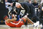 Alabama forward Javian Davis is helped off the floor after being injured in the second half of an NCAA college basketball game against Vanderbilt Wednesday, Jan. 22, 2020, in Nashville, Tenn. Alabama won 77-62. (AP Photo/Mark Humphrey)