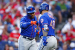 New York Mets' Dominic Smith, left, and Wilson Ramos celebrate after Smith's home run during the third inning of a baseball game against the Philadelphia Phillies, Tuesday, June 25, 2019, in Philadelphia. (AP Photo/Matt Slocum)