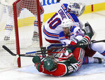 New York Rangers defenseman Brendan Smith (42) levels New Jersey Devils center Jack Hughes (86) in the crease of goaltender Alexandar Georgiev (40) during the third period of an NHL hockey game in Newark N.J., on Saturday, March 6, 2021. (Andrew Mills/NJ Advance Media via AP)