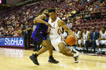 North Alabama guard Jamari Blackmon, left, is called for a foul as Florida State guard Anthony Polite, right, drives to the basket in the second half of an NCAA college basketball game in Tallahassee, Fla., Saturday, Dec. 28, 2019. (AP Photo/Mark Wallheiser)