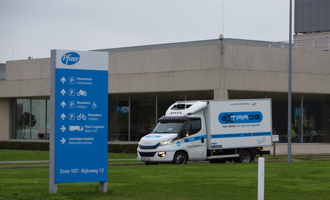 A refrigerated truck drives out of the Pfizer Manufacturing plant in Puurs, Belgium, on Thursday, Dec. 3, 2020. British officials on Wednesday authorized a COVID-19 vaccine for emergency use, greenlighting the world's first shot against the virus that's backed by rigorous science and taking a major step toward eventually ending the pandemic. (AP Photo/Virginia Mayo)