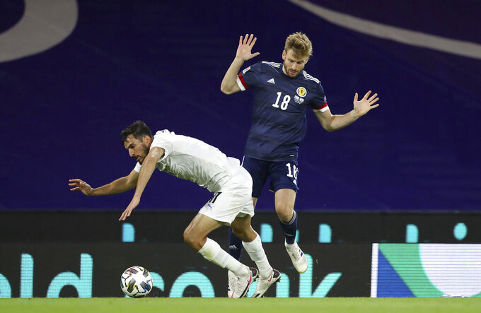 Israel's Hatem Abd Elhamed, left and Scotland's Stuart Armstrong battle for the ball , during the UEFA Nations League Group F soccer match between Scotland and Israel, at Hampden Park, in Glasgow, Scotland, Friday, Sept. 4, 2020. (Andrew Milligan/PA via AP)