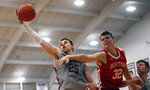 Colgate's Rapolas Ivanauskas (25) grabs a rebound from Boston University's Jack Hemphill (32) during the first half of the NCAA Patriot League Conference college basketball championship at Cotterell Court, Wednesday, March 11, 2020, in Hamilton, N.Y. (AP Photo/John Munson)