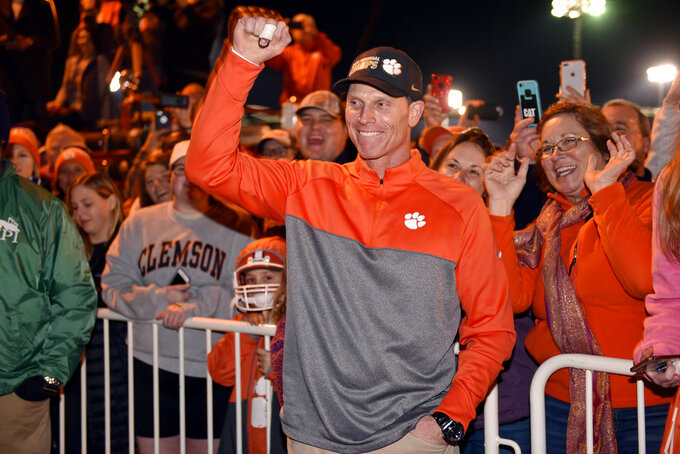 Clemson defensive coordinator Brent Venables acknowledges fans after the football team returned to campus Tuesday, Jan. 8, 2019, in Clemson, S.C., the day after the Tigers defeated Alabama 44-16 in the College Football Playoff championship game. (AP Photo/Richard Shiro)