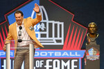 Steve Hutchinson, a member of the Pro Football Hall of Fame Centennial Class, speaks during the induction ceremony at the Pro Football Hall of Fame, Saturday, Aug. 7, 2021, in Canton, Ohio. (AP Photo/David Richard)