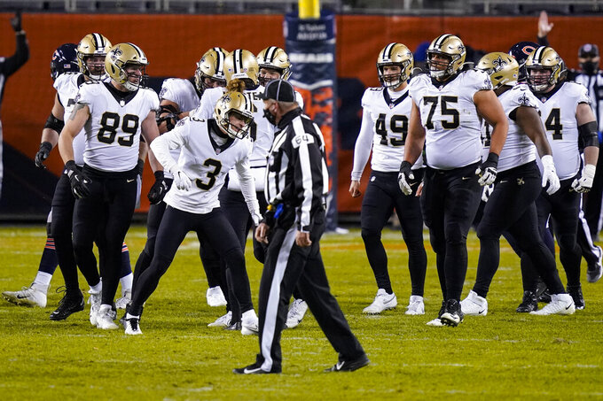 New Orleans Saints kicker Wil Lutz (3) celebrates after kicking a field during overtime to defeat the Chicago Bears 26-23 in a NFL football game in Chicago, Sunday, Nov. 1, 2020. (AP Photo/Charles Rex Arbogast)