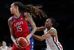 United States' Brittney Griner (15), left, drives past France's Sandrine Gruda (7) during women's basketball preliminary round game at the 2020 Summer Olympics, Monday, Aug. 2, 2021, in Saitama, Japan. (AP Photo/Charlie Neibergall)