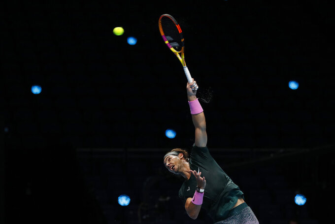 Rafael Nadal of Spain serves the ball to Daniil Medvedev of Russia during their semifinal match at the ATP World Finals tennis tournament at the O2 arena in London, Saturday, Nov. 21, 2020. (AP Photo/Frank Augstein)