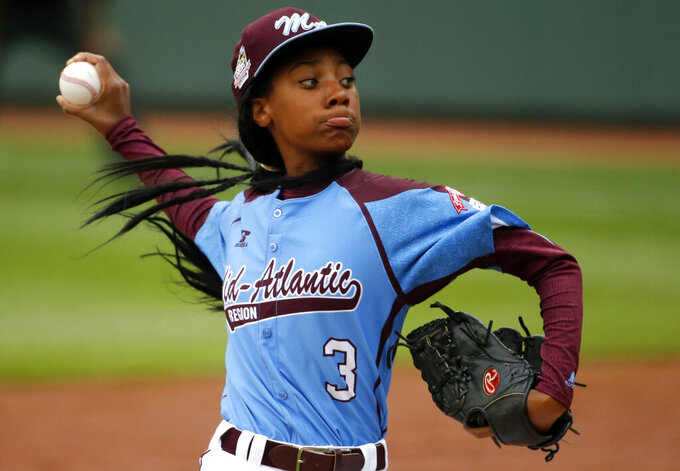 """FILE - In this Aug. 15, 2014, file photo, Pennsylvania's Mo'ne Davis delivers in the fifth inning against Tennessee during a baseball game at the Little League World Series tournament in South Williamsport, Pa. There are cities defined by their signature sporting events. """"This is who we are,"""" said Jason Fink, the chamber of commerce president in Williamsport, Pennsylvania, which has been synonymous with the Little League World Series since it was founded in 1947. (AP Photo/Gene J. Puskar, File)"""