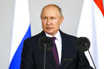 Russian President Vladimir Putin delivers his speech at the opening ceremony of the International Military Technical Forum Army-2021 in Alabino, outside Moscow, Russia, Monday, Aug. 23, 2021. (Ramil Sitdikov, Sputnik, Kremlin Pool Photo via AP)