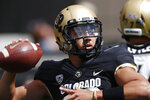 Colorado quarterback Steven Montez warms up before an NCAA college football game against Nebraska Saturday, Sept. 7, 2019, in Boulder, Colo. (AP Photo/David Zalubowski)