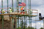 """FILE - In this June 11, 2020, file photo workers on scaffolding lay blocks on one of the larger buildings at a development site where various residential units and commercial sites are under construction in Cranberry Township, Butler County, Pa. Eighty-five percent of Democrats call economic conditions """"poor,"""" while 65% of Republicans describe them as """"good,"""" according to a new survey by The Associated Press-NORC Center for Public Affairs Research. (AP Photo/Keith Srakocic, File)"""