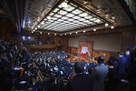 Japan's Emperor Naruhito, seated right, attends the opening of an extraordinary session at the upper house of parliament in Tokyo Friday, Oct. 4, 2019. (AP Photo/Eugene Hoshiko)