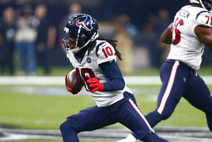 Houston Texans wide receiver DeAndre Hopkins (10) carries in the first half of an NFL football game against the New Orleans Saints in New Orleans, Monday, Sept. 9, 2019. (AP Photo/Butch Dill)