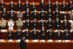 FILE - In this May 22, 2020, file photo, delegates applaud as President Xi Jinping arrives for the opening session of China's National People's Congress (NPC) at the Great Hall of the People in Beijing. (AP Photo/Ng Han Guan, Pool, File)