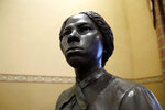 A bronze statue of abolitionist Harriet Tubman is seen during a private viewing ahead of its unveiling at the Maryland State House, Monday, Feb. 10, 2020, in Annapolis. The statue, along with a statue of Frederick Douglass, will be unveiled Monday night in the Old House Chamber, the room where slavery was abolished in Maryland in 1864. (AP Photo/Julio Cortez)