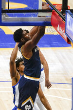 Notre Dame's Juwan Durham dunks in front of Pittsburgh's Noah Collier during the first half of an NCAA college basketball game, Saturday, Jan. 30, 2021, in Pittsburgh. (AP Photo/Keith Srakocic)