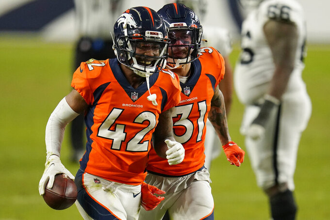 Denver Broncos free safety Justin Simmons (31) and cornerback Parnell Motley (42) celebrate after Motley recovered a fumble by the Las Vegas Raiders during the second half of an NFL football game, Sunday, Jan. 3, 2021, in Denver. (AP Photo/Jack Dempsey)