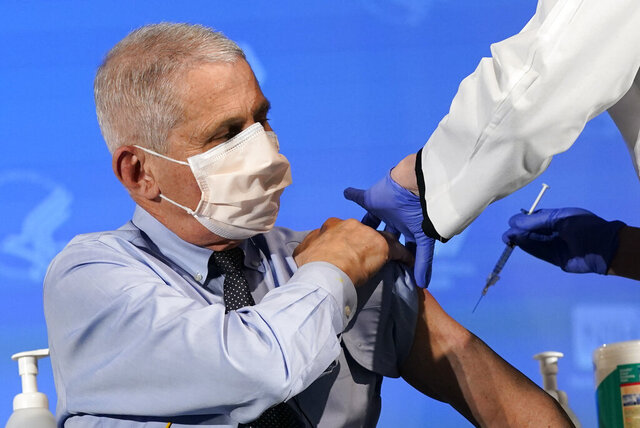 FILE - In this Dec. 22, 2020, file photo Dr. Anthony Fauci, director of the National Institute of Allergy and Infectious Diseases, prepares to receive his first dose of the COVID-19 vaccine at the National Institutes of Health in Bethesda, Md. (AP Photo/Patrick Semansky, Pool, File)