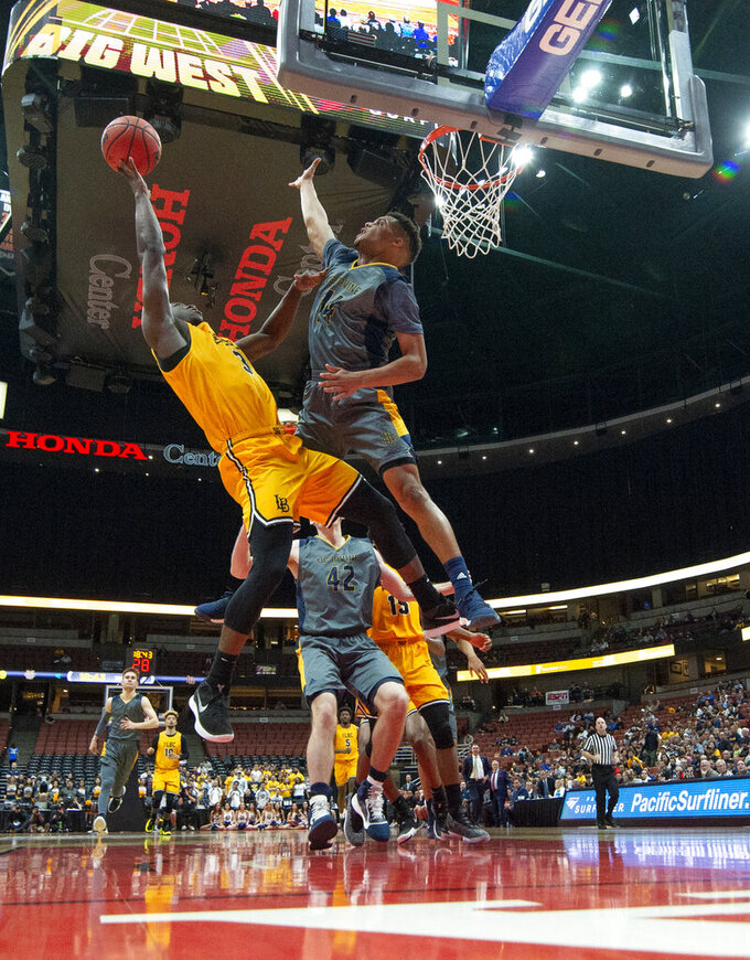UC Irvine guard Evan Leonard, right, tries to block the shot by Long Beach State guard Drew Cobb during the second half of an NCAA college basketball game at the Big West men's tournament in Anaheim, Calif., Friday, March 15, 2019. (AP Photo/Kyusung Gong)