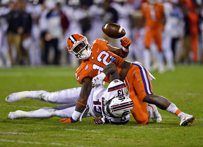 Clemson's K'Von Wallace (12) breaks up a pass intended for South Carolina's Shi Smith during the first half of an NCAA college football game Saturday, Nov. 24, 2018, in Clemson, S.C. (AP Photo/Richard Shiro)