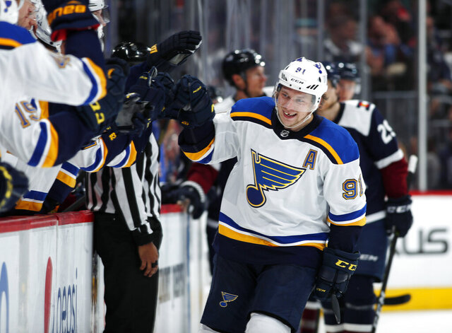 FILE - In this Feb. 16, 2019, file photo, St. Louis Blues right wing Vladimir Tarasenko, right, is congratulated as he passes the team box after scoring a goal against the Colorado Avalanche during the third period of an NHL hockey game in Denver. Tarasenko makes his return after early season shoulder surgery that limited him to three goals in 10 games. (AP Photo/David Zalubowski, File)